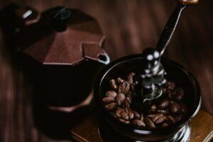 coffee beans in black ceramic mug