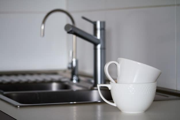 two clean white tea cups near metal sink 94863 1475