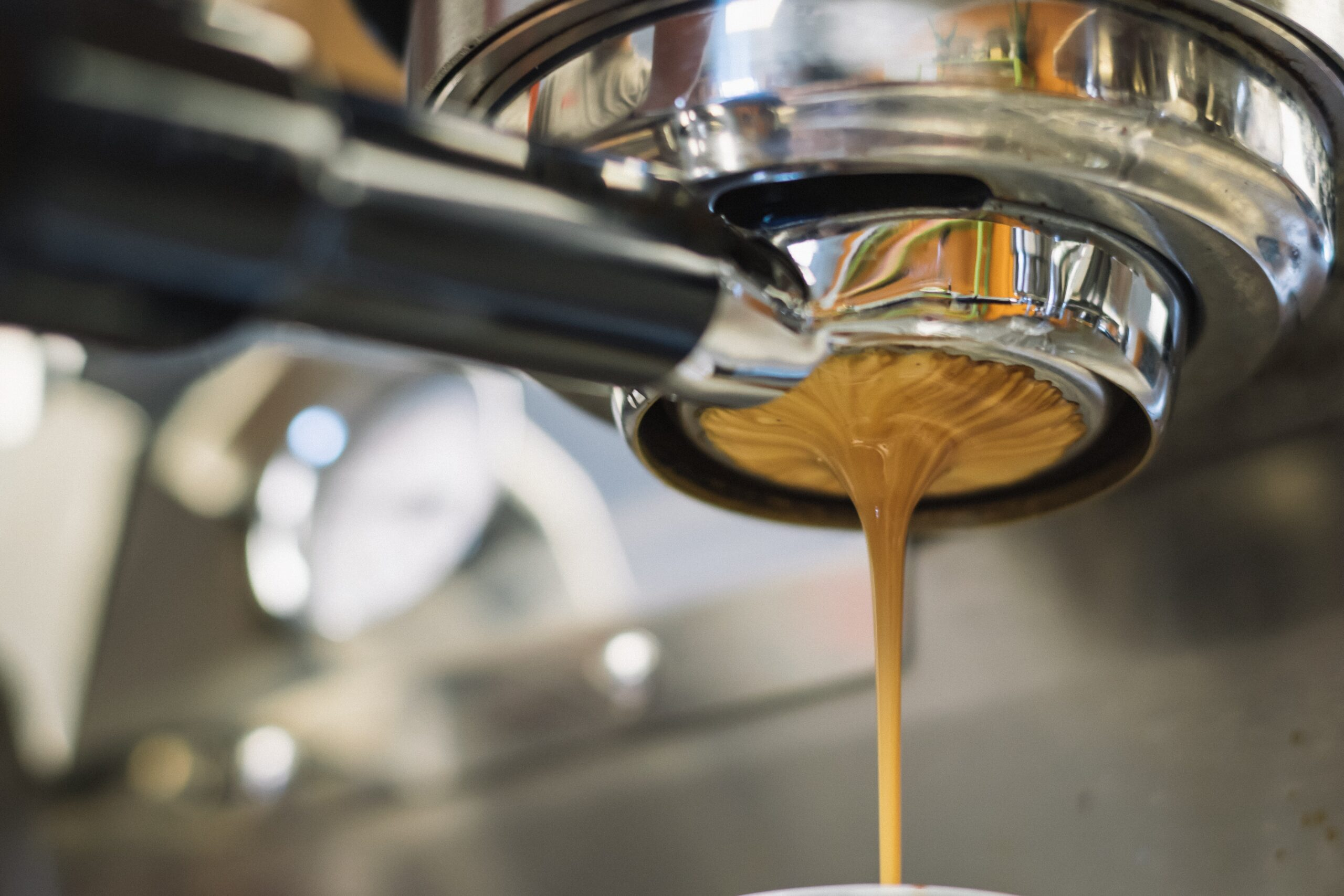 Latte dripping from a coffee machine