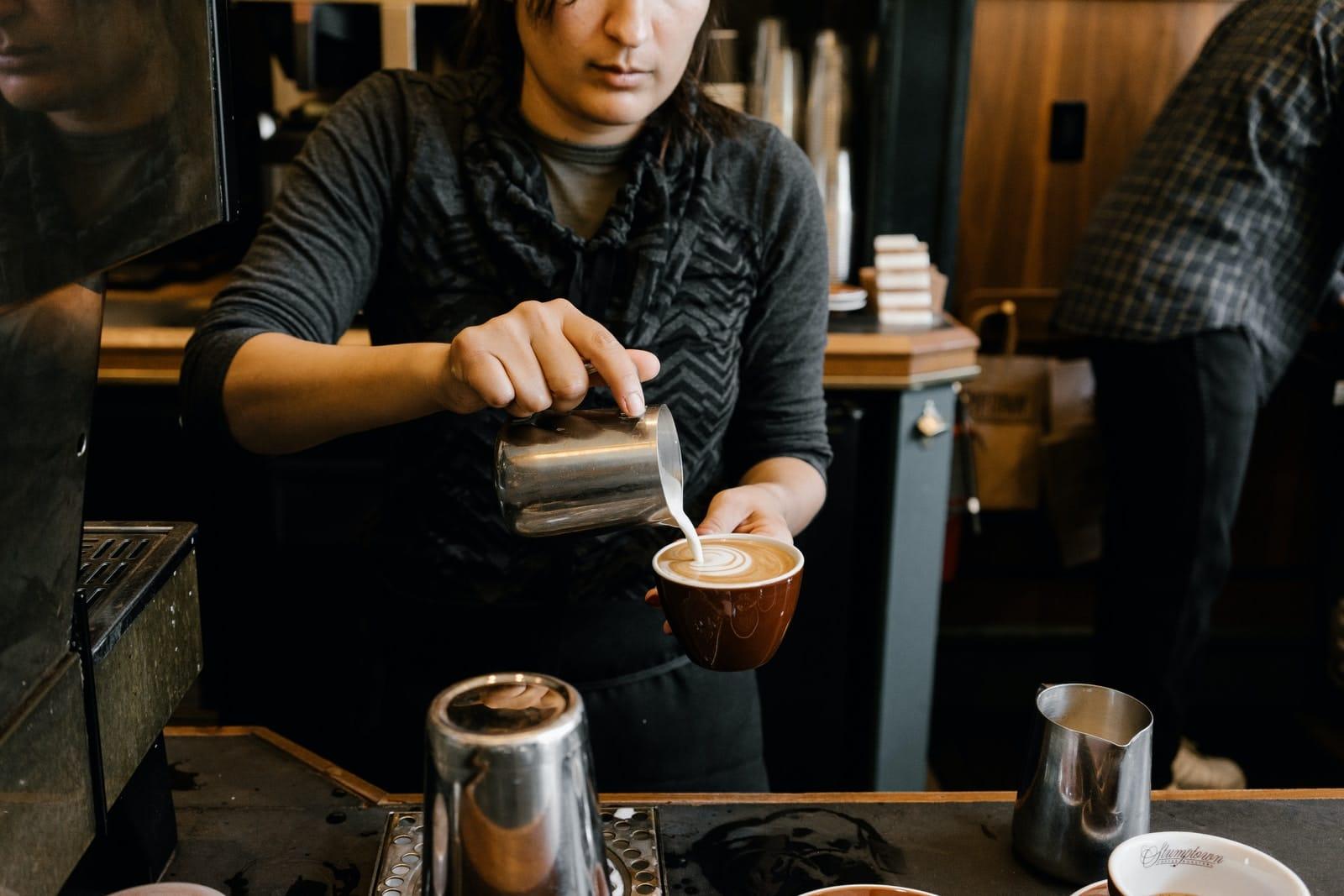 person making latte