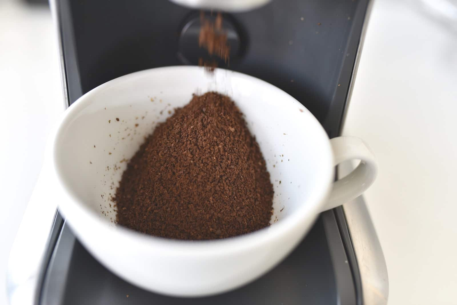 white ceramic cup with brown powder inside